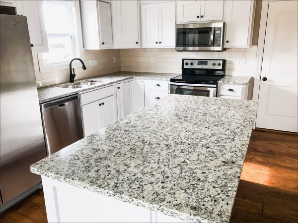blue flower granite with white cabinets scaled